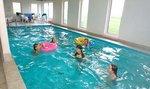 455 m2 Poolhus med plads til 24 personer, (30 ved tilvalg af lejlighed) 9 værelser, 28m2 poll, sauna